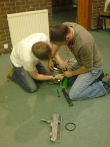 How many men does it take to fix a vacuum cleaner?