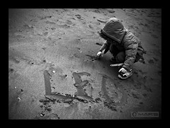 I wrote your name on the sand (- FREDERIC MARS -) Tags: white black beach kid sand poem noir leo name sable write honfleur enfant plage blanc nom ecrire pome abigfave platinumphoto rubyphotographer