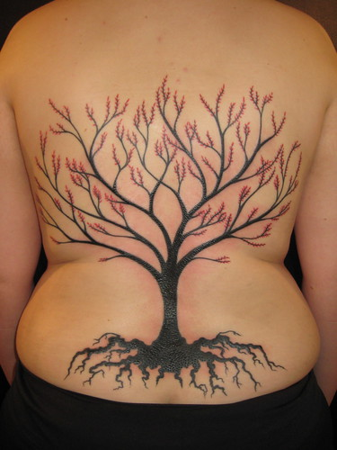 Tattoo adjures growing on girl back
