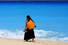 Mayan Woman Walking on the Beach in Cancun by Ricardo Carreon