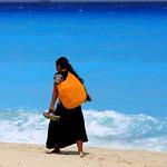 Mayan woman walking on the beach in Cancun