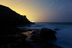 Extinction #3 (Jurassic Coast Star Trails), Dorset (flatworldsedge) Tags: longexposure blue light lighthouse mist night star coast rocks surf cloudy trails pollution dorset jurassic rockpool yahoo:yourpictures=landscape yahoo:yourpictures=waterv2 yahoo:yourpictures=england2013