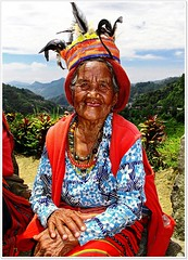 Banaue in her smile (315Edith) Tags: old red smiling philippines oldwoman banaue ifugao headdress cordilleras northernluzon facesofportraits canong12 nativecloth