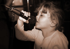 Paige singing the blues 1 8171 (casch52) Tags: 20d sanantonio canon children photo kid san texas child paige blues photograph sing singer karaoke microphone mic antonio explorer242 familygetty