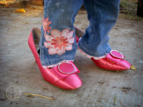 she wears pink shoes