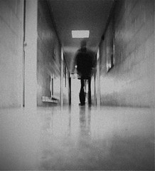 sshhh through the corridor...... (Barry McGrath) Tags: school bw white black photoshop walking slow ghost grain corridor spooky ixus peter shutter wandering ghosting cs3 canonixus800is aplusphoto barrymcg bazzymcg droghedagrammarschool overexposued