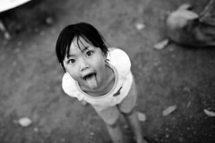 You'll Be Stuck If The Wind Changes... (mahonyweb) Tags: bw asian thailand interestingness interesting asia explore thai littlegirl canon5d siam lampang lightroom thaigirl thestreet top500 flickrexplore 35l magicdonkey canonllens canonef35mmf14lusm canon35mmf14 mahonyweb wwwmahonywebcom