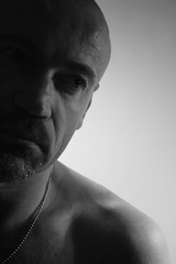 Older (just.Luc) Tags: shirtless portrait bw selfportrait man eye me face self silver mouth nose sadness goatee crazy chain precious eyebrow ear older sweetie charming melancholy shavedhead shoulder wrinkles wrinkle clever 46 collarbone individualist clavicle ohsosexy sensualandcapable
