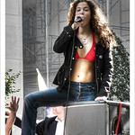 red bikini, blue jeans and a mic in hand thumbnail