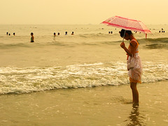 Chinese Beach Fashion - Umbrella (Life in AsiaNZ) Tags: china people woman hot beach water beauty fashion umbrella canon asian sand asia waves dress g chinese powershot chapeau series  paddling   beihai  guangxi silverbeach   g9 gseries   canong9  lifeinnanning chinesebeachfashion flickrgiants