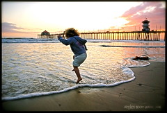 Freedom (SMGallery (MooreFoto.com)) Tags: ca color beach freedom jump bravo lily playa huntingtonbeach soe onblack littlestories supershot abigfave artlibre platinumphoto superbmasterpiece smgallery picswithsoul mastersoflifegallery