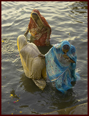 Three Graces (bjornra) Tags: blue red woman india color water yellow trois three women varanasi bathing hindu tre sari hindi femmes inde ganges benares coulor supershot kvinnor wowiekazowie earthasia warshipping