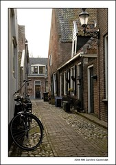 Elburg (Caroline Castendijk) Tags: door flowers netherlands dutch bike bicycle photography alley caroline cobblestones explore cc event walkway curacao narrow elburg allrightsreserved steegje fiets yourfavorite carolinecastendijk castendijk 2008carolinecastendijk fotografiecuracao curaaofotografie curacaofotografie carolinecastendijkphotography photographycuraao carolinecastendijkfotografie carolinecastendijkphotographer