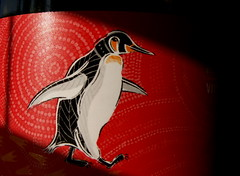 the Little Penguin (marni*) Tags: light shadow red macro penguin interesting wine redwine monday winelabel rayofsun thelittlepenguin haveagreatmonday macromonday haymarni