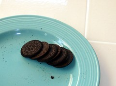 this is how 11 year old girls eat an oreo. (godswork96) Tags: party cookies yum chocolate slumber oreo sleepover