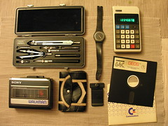 The items I carry (1986 version) (Riccardo Mori) Tags: home vintage logo table swatch nikon walkman watch indoors floppy calculator coolpix commodore lettering 1986 geos compasses 8800 theitemswecarry bowcompass