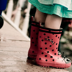 more with the boots. :) (cinco de kiddo) Tags: cold rain weather easter fun puddle spring mud boots egg polkadots rainy ladybug galoshes blustery egghunt interestingness16 i500