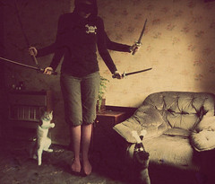 Load up on guns,Bring your friends (oladios) Tags: cats selfportrait mask nirvana kittens swords 52 2b oladios