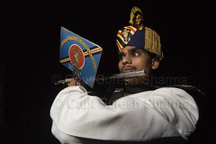 Flute Player of the Indian Military Band, EME (Captain Suresh Sharma) Tags: music india hat logo soldier army concentration uniform asia display stripes delhi handsome exhibit flute crest entertainment recreation turban musicalinstrument youngman brassband flutist headgear publicdisplay ceremonial flautist eme militaryband armyband ceremonialdress youngsoldier indianflutist indiansoldier insgnia captsureshsharma organisedactivity organizedactivity indianflautist corpsofelectricalandmechanicalengineers