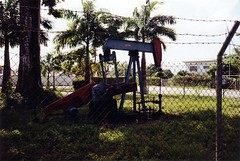 Close-up of pumpjack (Will S.) Tags: trees film palms palmtrees trinidad grasshopper mypics grasshoppers noddingdonkey pumpjack trinidadandtobago pumpingunit noddingdonkeys pumpjacks beampump pumpingunits jackpump thirstybird jackpumps rodpump horseheadpump horseheadpumps beampumps rodpumps thirstybirds