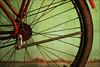 santarem bike - study in green red and black #1 (chirgy) Tags: red brazil green texture k bike bicycle wheel brasil hub mud para spokes tread santarem interestingness374 i500 plasser