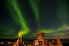 Northern lights above Inukshuk (Rolf Hicker Photography) Tags: world travel light sky canada nature spectacular stars outdoors lights symbol scenic manitoba arctic churchill nightsky symbols northern inukshuk mystic northernlights auroraborealis rockformations hudsonbay inukshuks rockformation travelphotography canadianarctic rolfhicker top20aurora theperfectphotographer honeymooncanada hickerphotocom