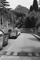 CNV00028s (Cameron A. Straughan) Tags: travel tourism eccentric quirky surreal odd architecture street history angles lines culture 35mm exposures film developing 400 iso real photography traditional photographs fuji stx2 camera processing tamron zoom lens 35 mm manual black white photos classic old school ilford taormina hill mountains sicily mount etna active volcano teatro antico di ancient greco¬roman godfather francis ford coppola italy