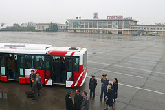 PRK-Pyongyang-0811-003-v1 (anthonyasael) Tags: travel urban building bus hat horizontal architecture buildings uniform asia republic exterior duty north transport formal hats places scene korea du structure wear east cap journey transportation anthony arrival traveling far democratic headdress headwear arriving pyongyang headgear dprk coreadelnorte asael of    nord  coree welldressed