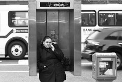 she's on a cell phone in the phone booth  L1047216.jpg (Susan NYC) Tags: street nyc woman phonebooth cellphone mcny leicam8 pwpp