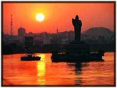 G'bye Hyderabad! (plsssnraju) Tags: sunset sun india lake reflection water silhouette statue buildings boat metro buddha redsky hyderabad budda hussainsagar gautambudda