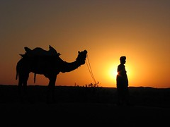 Camel and owner (*shutterbug_iyer*) Tags: sunset orange india silhouette sam desert camel jaisalmer rajasthan marwar nikonstunninggallery superaplus aplusphoto platinumheartaward