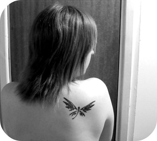 Dragonfly Tattoo Upper Back. For a lady who wants to look tough with a