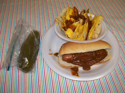 lunch: chili hot dog, chili cheese nachos and a dill pickle