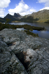 Cradle Mountain (Stephen van der Mark) Tags: world blue trees wild sky mountain lake mountains color colour tree art heritage nature wet water colors beautiful rock clouds digital canon landscape photography eos photo site amazing nice bravo scenery view natural australian australia views stunning tasmania portfolio aussie tas tassie 1ds downunder dovelake tasmanian lavish worldheritagearea worldbest buttongrass superbmasterpiece wombathabitat bestofaustralia betterthangood