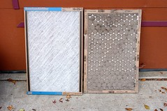20051127_3102...Clean furnace filter and dirty furnace filter (listorama) Tags: home dirt driveway cardboard furnace filters paperboard