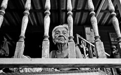 Older Elderly sister looking down - bangkok