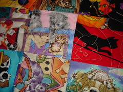 cat quilting on cat fabric in cat charm quilt