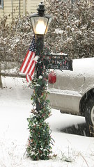 Lamp Post (Petunia21) Tags: christmas light snow newyork lamp bulb lights post flag garland american rockland rocklandcounty nanuet december132007 southparkavenue lexowavenue