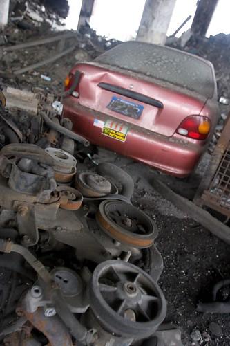 abandoned car and engine blocks