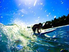 Surf's Up (Timhaiti) Tags: ocean blue sea sky sun beach water canon eos stand haiti surf waves surfing drop spray surfboard splash saltwater 400d digitalrebelxti aplusphoto
