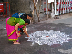 India - Sights & Culture - Women drawing an intricate kolam outside the Mylapore Temple (mckaysavage) Tags: india temple chalk tn drawing madras welcome chennai tamil tamilnadu kolam nadu