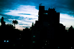 Sunday (autumn_bliss) Tags: blue sunset brazil silhouette azul brasil clouds buildings portoalegre prdosol prdios rainclouds canonef70200f4lusm