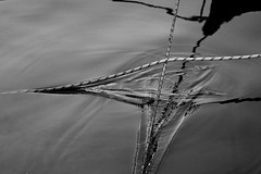 Friction with a touch of pessimism - 20080705_0531edbw (Dimitris Papazimouris) Tags: bw art angles july ropes hydra symbolic metaphore friction canon30d canon24105f4 greecegreek realathionship