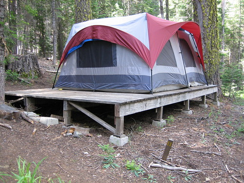 Image of 4 man tent on a wooden platform