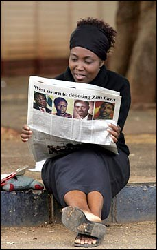Zimbabwe resident reads the pro-government newspaper which explains how the imperialist nations are working to overthrow the ZANU-PF ruling party. by Pan-African News Wire File Photos