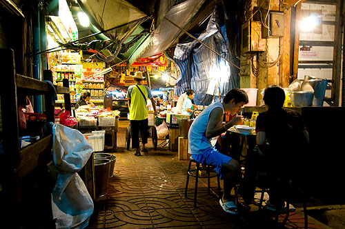 Charoen Krung Soi 16, a market alley that at night also functions as the dining room for a stall serving kuaytiaw khua kai