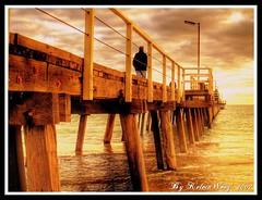 Golden Jetty (Kelvin Wong (Away)) Tags: wood light sunset sea sky people beach nature water clouds golden jetty australia human adelaide southaustralia henleybeach superaplus aplusphoto favemegroup3 kelvinwong piscesromance
