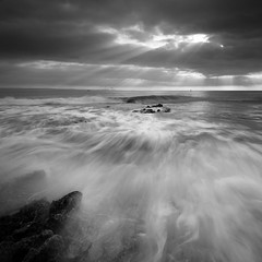 Monknash Rocks III (Adam Clutterbuck) Tags: ocean uk greatbritain sea blackandwhite bw seascape monochrome wales square landscape mono blackwhite bravo unitedkingdom britain wave spray bn elements glamorgan gb blogged bandw sq surge oe nashpoint greengage monknash heritagecoast adamclutterbuck sqbw bwsq showinrecentset walglamheri openedition