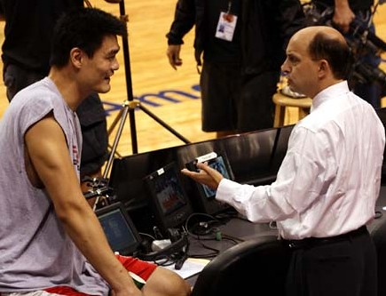 Yao Ming meets with former Rockets coach Jeff Van Gundy before the Houston-Miami game Friday night, November 23rd.  Van Gundy was the ESPN television analyst for the game.  This happened to be the most interesting photo from the night because the Rockets didn't do anything interesting on the court, losing to a struggling Miami team.  Houston has now lost 6 in a row and dropped below .500.