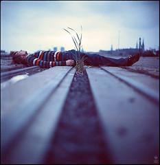 gestrypp (romanraetzke) Tags: portrait man rio analog mediumformat kodak hamburg squareformat mann blau hafen kiev ektachrome pullover farben boden schienen 64t gestreift liegen mittelformat liegend gestrypp
